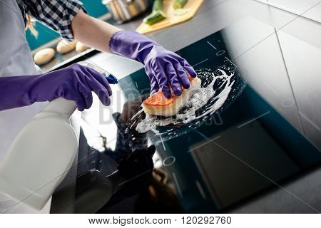 Woman's Hands Cleaning Kitchen Top In Protective Gloves