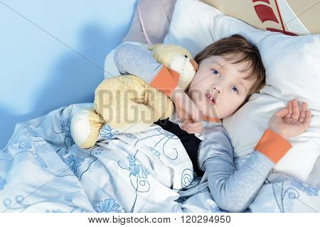 Portrait Of A Sick Boy Hugging A Teddy Bear