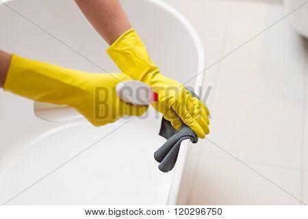 Cleaning Bath In Bathroom.