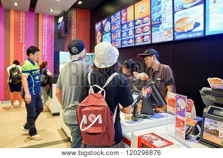 BANGKOK, THAILAND - JUNE 21, 2015: inside of McDonald's restaurant. McDonald's is the world's largest chain of hamburger fast food restaurants