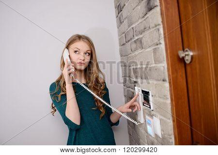 Blonde Woman Talking On The Intercom