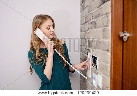 Woman Talking On The Intercom