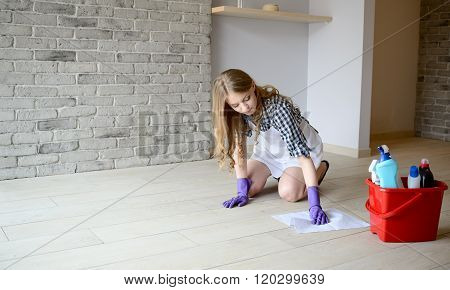 Woman Washes The Floor In The Room On Her Knees.