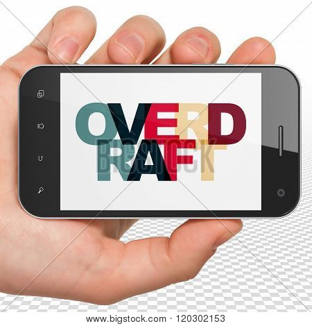Finance concept: Hand Holding Smartphone with Overdraft on  display