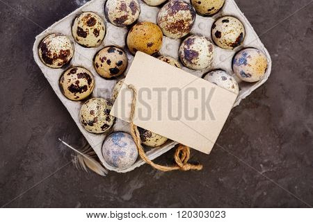 Quail eggs and a blank tag with copy space