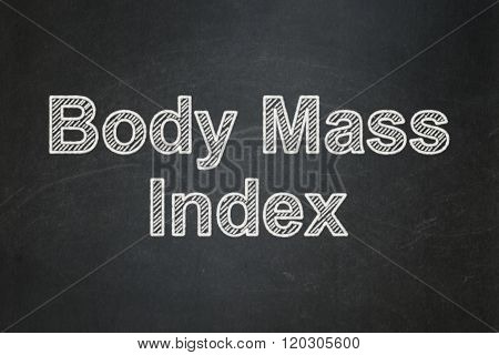 Health concept: Body Mass Index on chalkboard background