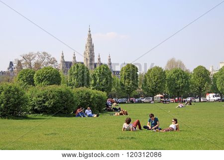 Vienna, Austria - April 25, 2013: People Relaxing In A Park In Vienna Near Hofburg Imperial Palace W