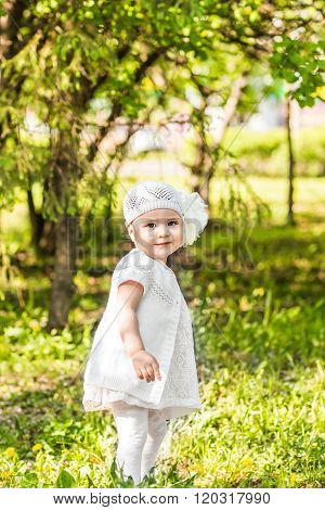 Cute smiling baby girl outdoors