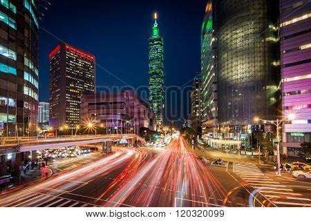 Traffic On Xinyi Road And View Of Taipei 101 At Night, In Taipei, Taiwan.