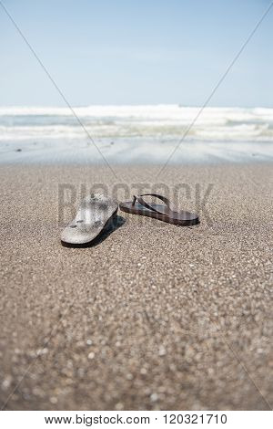 Flip flops on a sandy beach stock picture