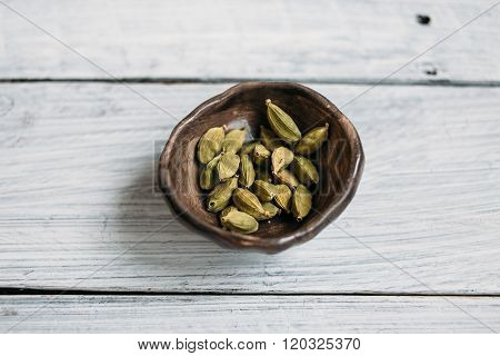 Grains Of Cardamom In Pottery
