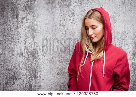 Attractive young woman wearing red hoodie