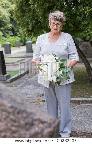 Holding A Floral Tribute
