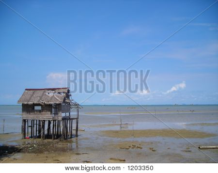 Single Abandoned Hut By The Beach