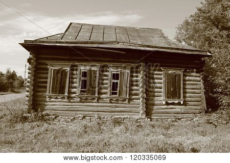 Old abandoned one-storey wooden log house in russian village