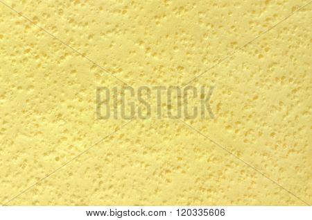 Yellow sponge surface as background. Macro image.