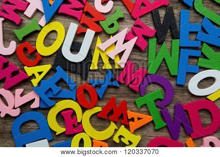 Surface covered with multiple colored wooden letters