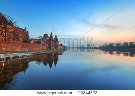 The Castle of the Teutonic Order in Malbork at dusk, Poland