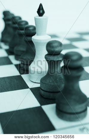 Troop pawns and King on a chessboard.