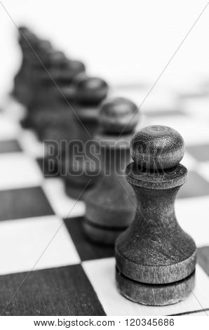 Troop pawns on a chessboard.