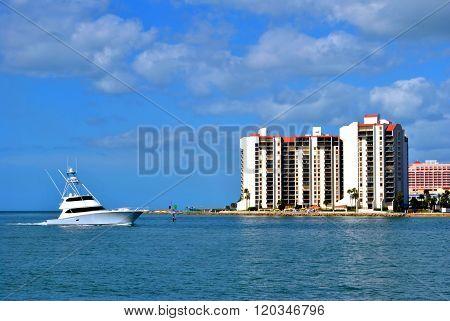 A yacht sailing along Sand Key coast in Florida