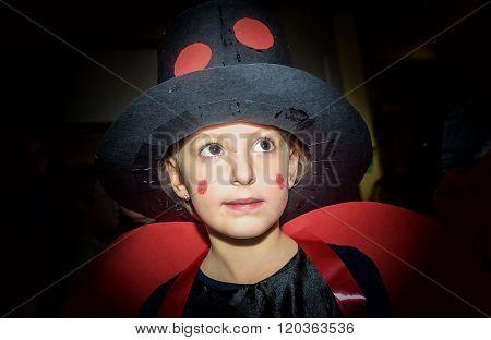 Little Girl In Ladybug Costume For School Maskenball