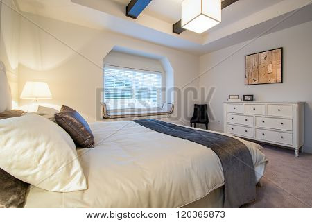 Modern bright bedroom interior with designer pillows in a luxury house hotel.