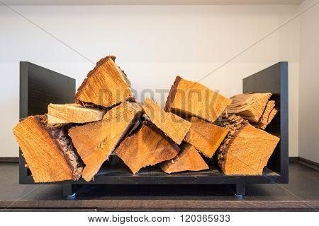 Log holder tray full of logs. Fireside storage.