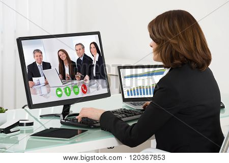 Businesswoman Videoconferencing With Colleagues On Computer