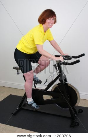 Woman On Exercising Bike