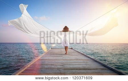 Female angel rising above the sea