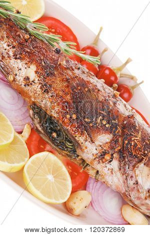 savory: whole fried sunfish over plate with tomatoes lemons and peppers
