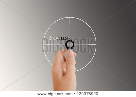 Isolated Hand With Lens And Text Focus With Target Sign On Light Platinum Background