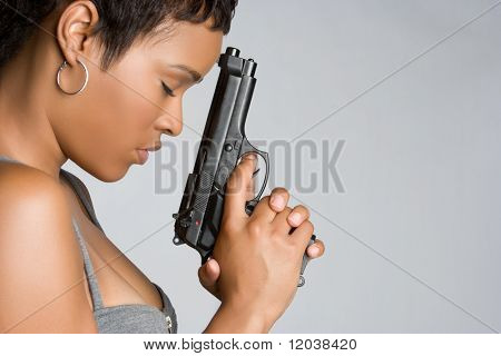African American Woman Holding Gun