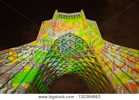 Illuminated Azadi Monument With Colorful Texts And Shapes