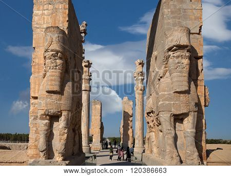 People Passing The All Nations Gate In Persepolis Of Iran