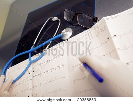 Doctor's Office During A Patient Data Examination