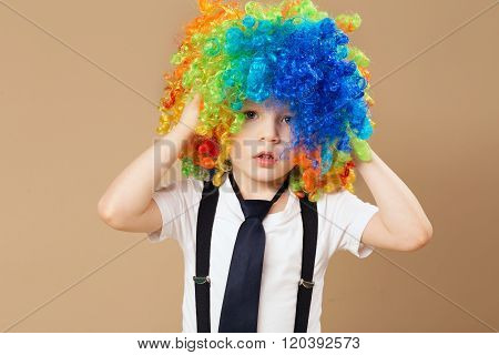 Little Boy In Clown Wig Smilling And Having Fun
