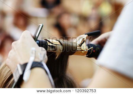 stylist hairdresser doing haircut