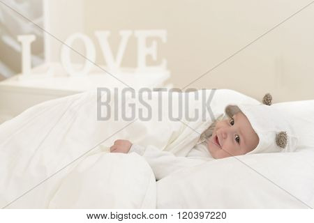 Happy Baby In Bed
