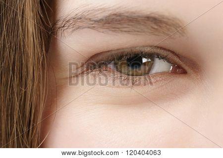 smiling young woman green-brown hazel eye closeup photo
