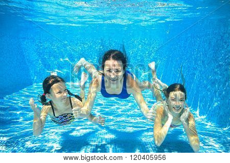 Family swim in pool underwater, happy active mother and children have fun under water, kids sport