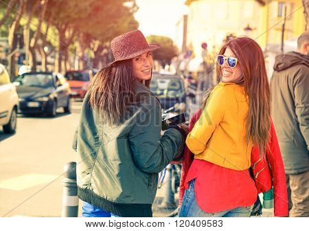 Beautiful Women Looking Back To Camera While Walking In Old City Center - Best Friends Girls -