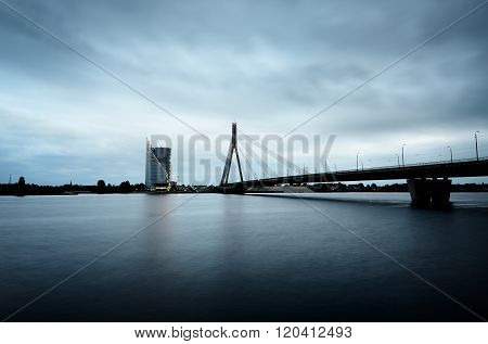 Daugava River and cable stayed bridge (Vansu tilts) panorama in Riga, Latvia, on a cloudy dark day