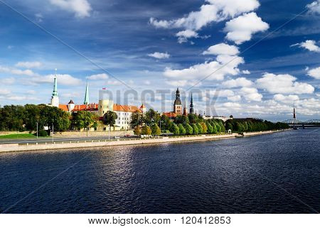 General view on Riga embarkment with President Palace, Old City towers and Gauja River. Beautiful summer sky with clouds. Latvia. poster