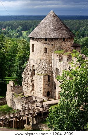 View of Cesis castle tower. Medieval castle in the forest. Landmark of Latvia.