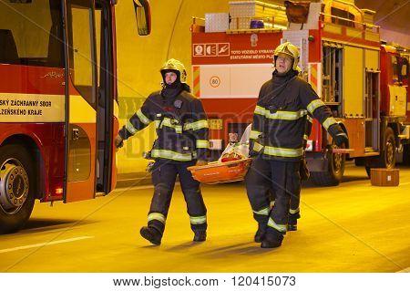 CZECH REPUBLIC, PLZEN,  30 SEPTEMBER, 2015:Firefighters carry a stretcher with injured
