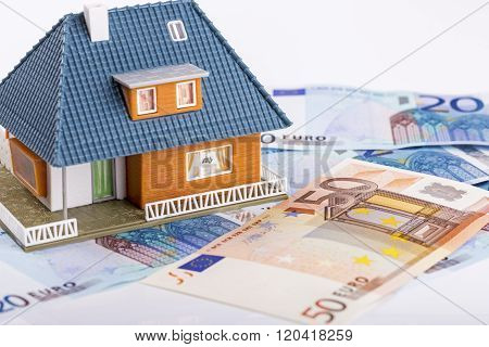 Miniature House Model On Euro Money Banknotes