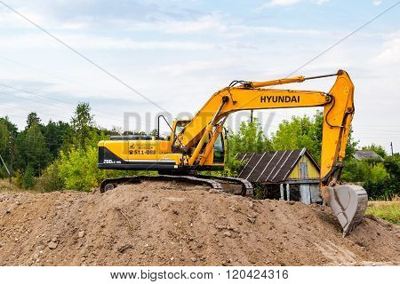 Hyundai Excavator At Construction Site In Summer Sunny Day