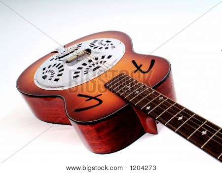 a lying dobro guitar with the neck